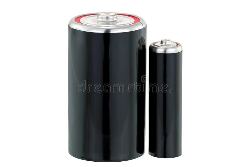 Svart torr cell D och motorförbundet storleksanpassar batteriet i svart royaltyfri foto