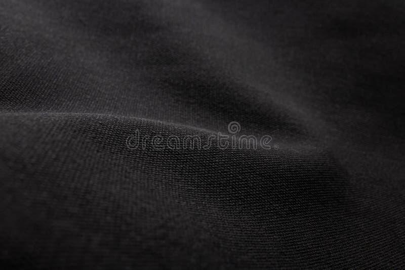 svart tygtextur f?r bakgrund Detalj av kanfastextilmaterial royaltyfria bilder