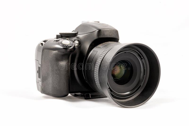 Svart unbranded DSLR-kamera som isoleras på vit bakgrund royaltyfria bilder