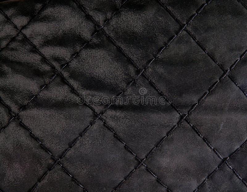 Svart vadderad läderbackgound royaltyfri bild