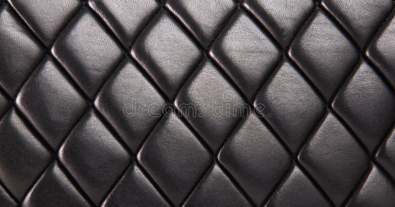 Svart vadderad läderbakgrund arkivbild