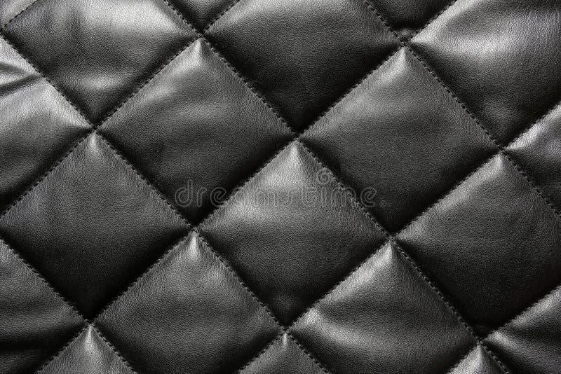 Svart vadderad läderbakgrund royaltyfria foton
