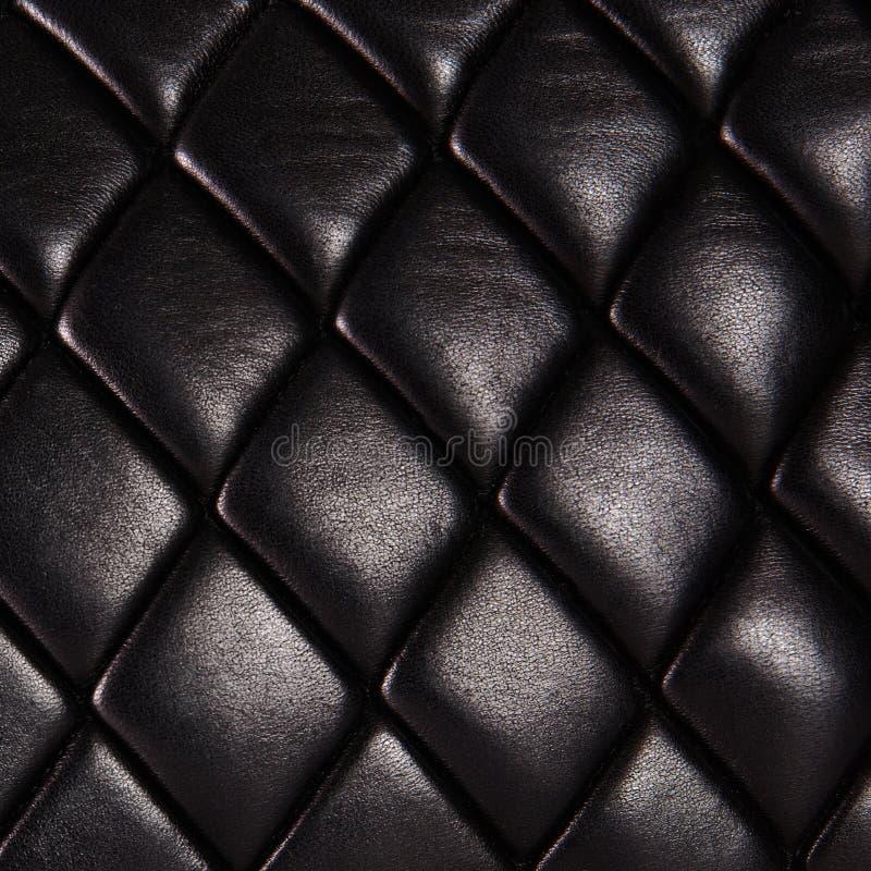 Svart vadderat naturligt läder royaltyfria foton