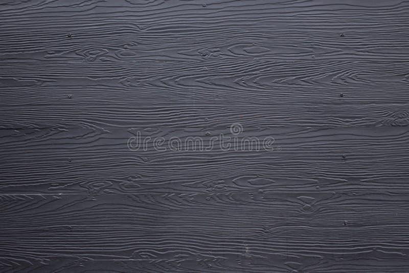 Svart wood plankapaneltextur royaltyfri bild