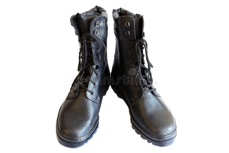 Svarta armékängor på vit bakgrund Specialt skodon isolerat Ett par av militära kängor Inga personer arkivfoto