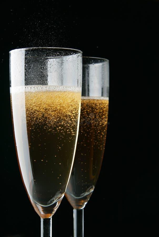 svarta champagneexponeringsglas över arkivfoton