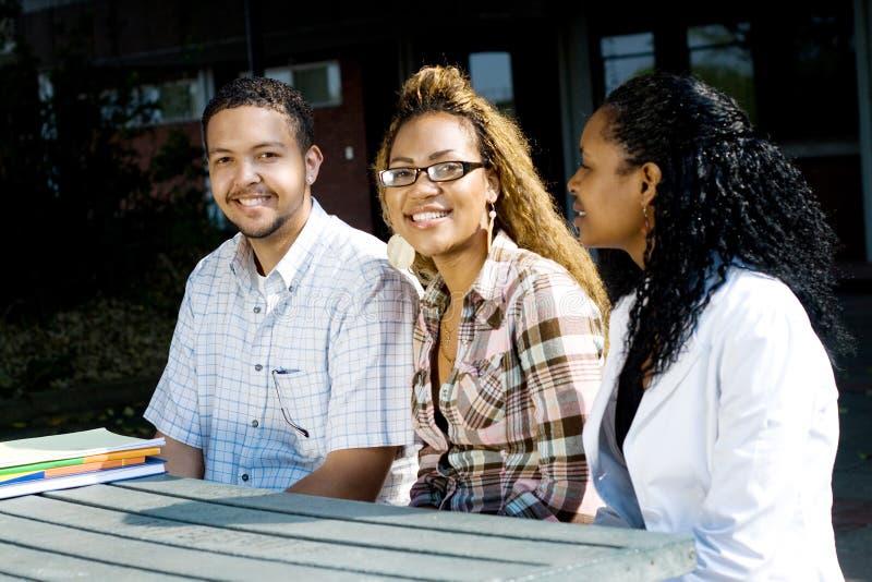 svarta deltagare royaltyfria bilder