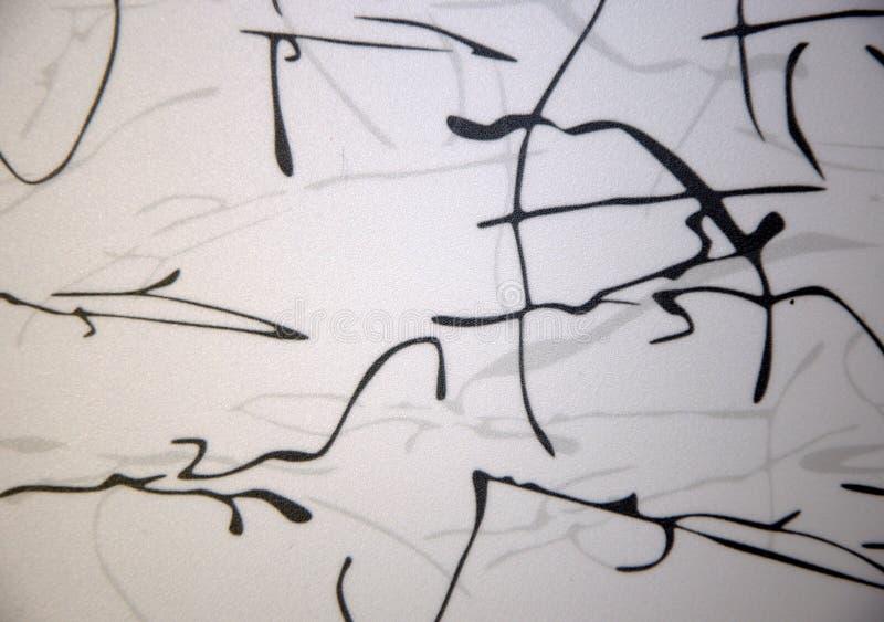 Svarta färgpulverfläckar på en vit bakgrund Textur bakgrund, närbild royaltyfria bilder