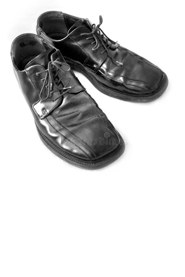 svarta klänningskor royaltyfri foto
