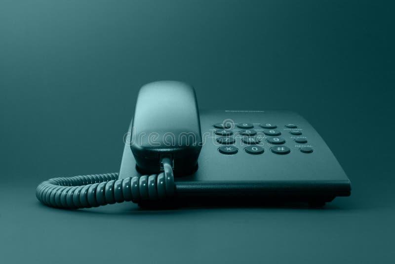 svarta kontorstelefonheltäckande royaltyfria foton