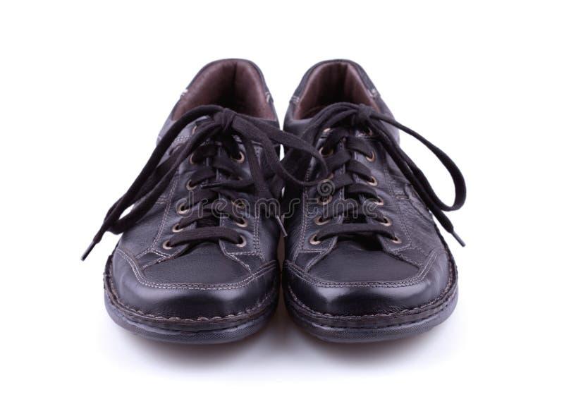Svarta lädermäns skor royaltyfria bilder