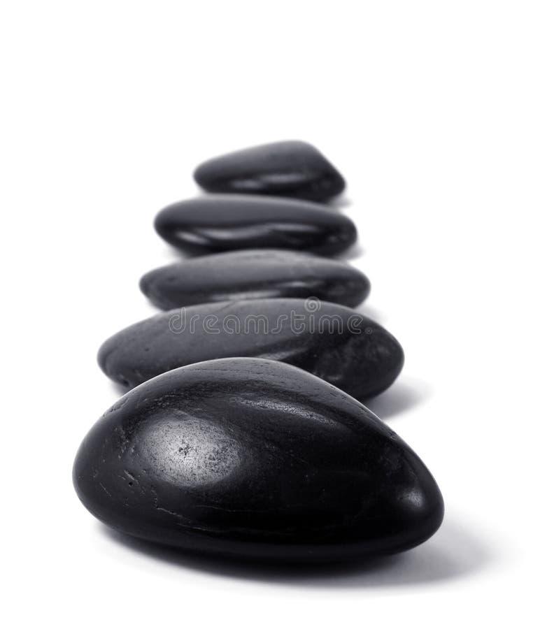svarta pebbles royaltyfria bilder