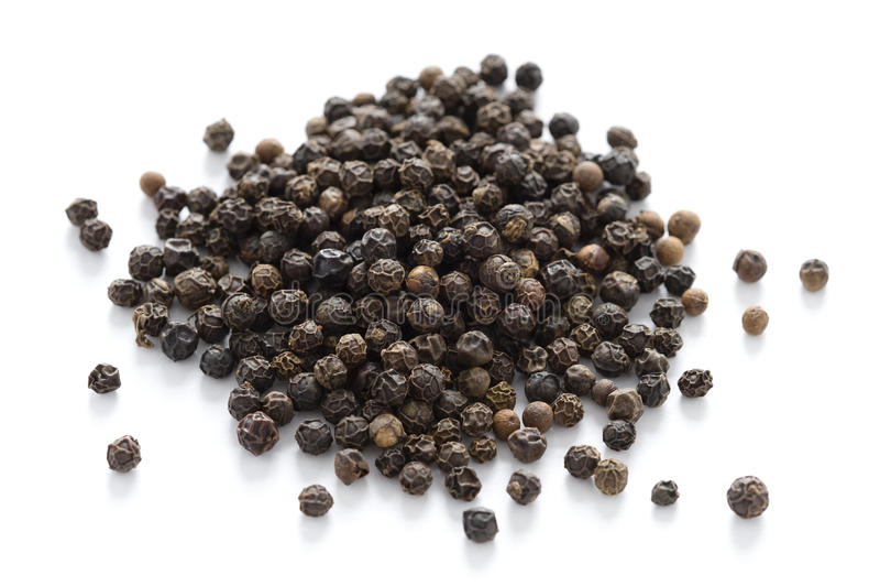 svarta peppercorns royaltyfri foto