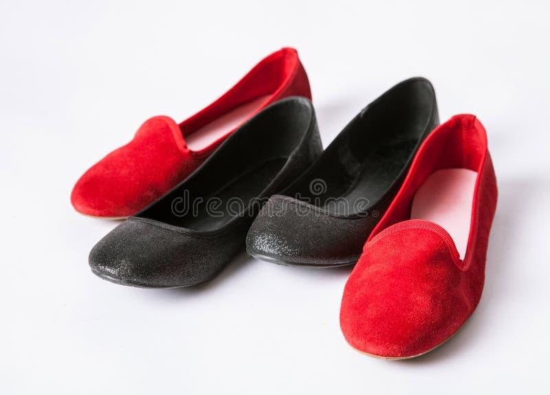 svarta röda skor fotografering för bildbyråer