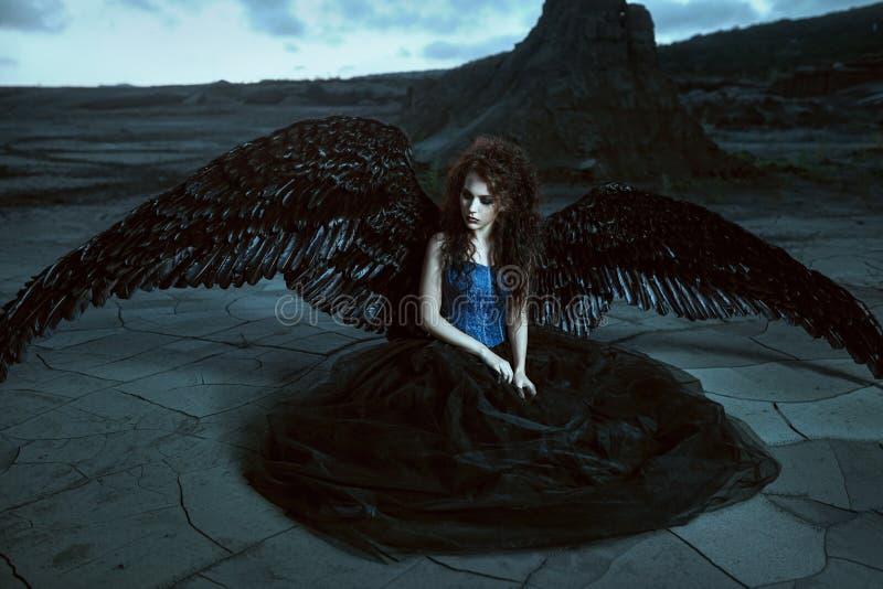 svarta vingar för ängel royaltyfria foton