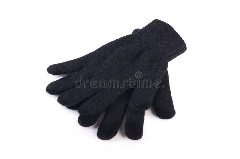 Svarta woolen handskar som isoleras på vit royaltyfria bilder