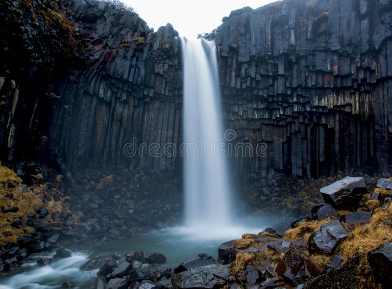 Svartifoss waterfall surrounded by basalt columns stock photography