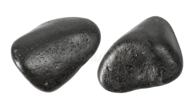Svartstenar som isoleras p? vit bakgrund Massagesten f?r bruk i brunnsort Snabb bana royaltyfri fotografi