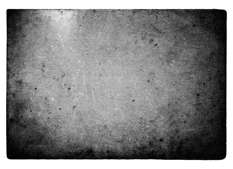 Svartvit filmram med ljusa läckor och korn som isoleras på vit bakgrund royaltyfria bilder