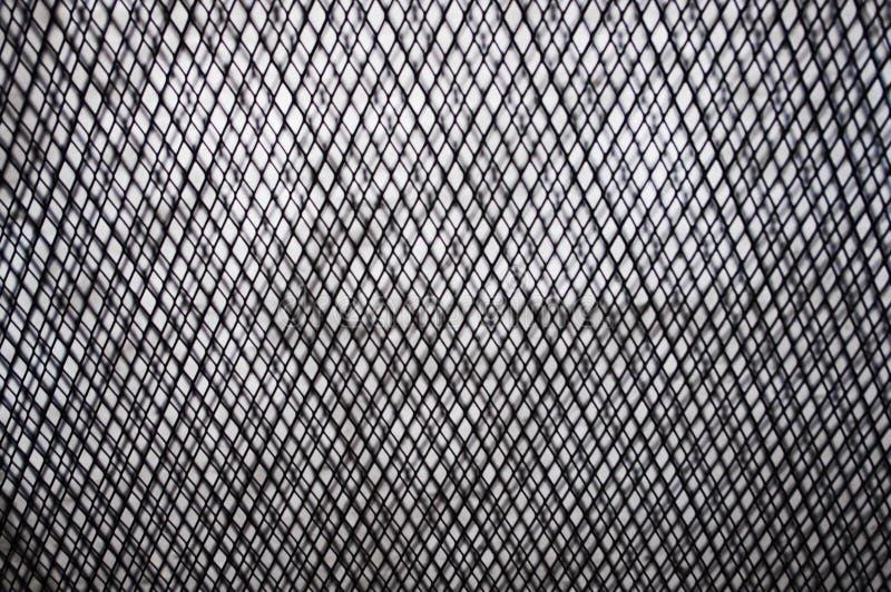 Svartvit textur ut ur tråd eller steeckmetall som bakgrund med den orange tonen royaltyfri foto