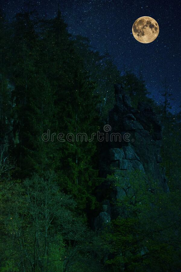 Svatosske rocks above the river Ohre in the night. Is a full moon. royalty free stock photos