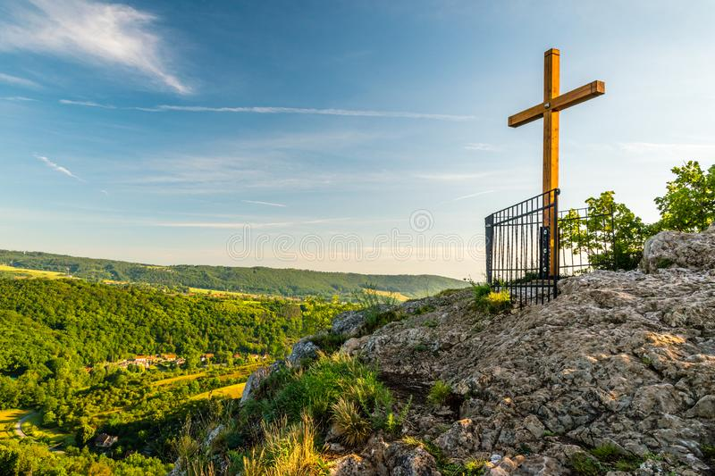 Svaty Jan pod Skalou summit cross at sunrise, Beroun District, Central Bohemian Region, Czech Republic. Svaty Jan pod Skalou summit cross in morning, Beroun stock photos