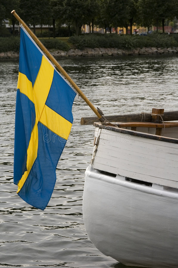 Svedish flag. A view of a boat with a swedish flag stock photo