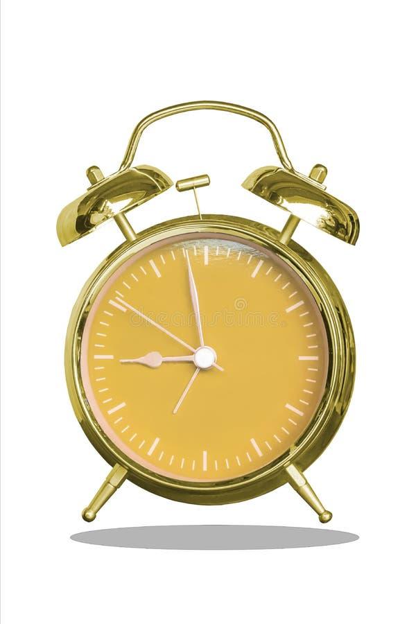 Sveglia isolata con un oro e un quadrante arancio su un fondo bianco con il percorso di ritaglio fotografie stock libere da diritti