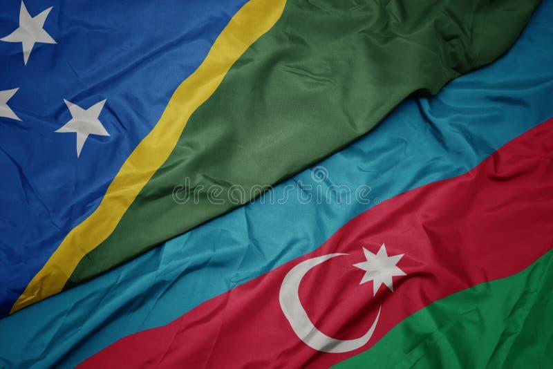 sventolando bandiera dell'azerbaigian e bandiera nazionale delle Isole Salomone fotografia stock libera da diritti