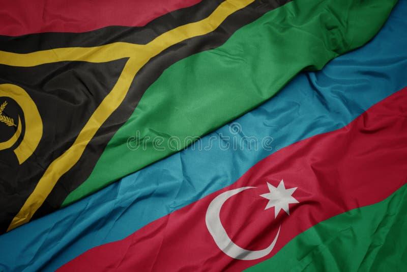 sventolando bandiera dell'azerbaigian e bandiera nazionale di Vanuatu fotografie stock libere da diritti