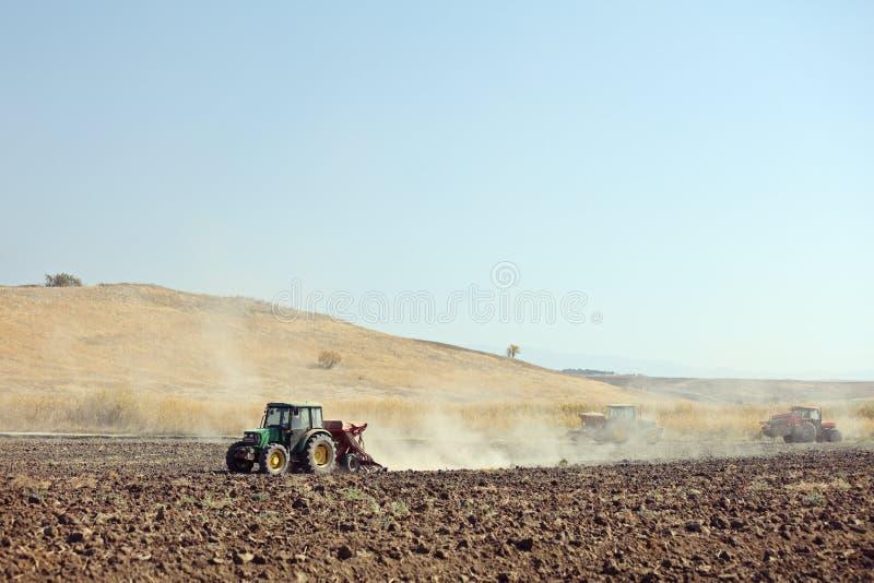 Sveti Nikole, Macedonia October 17, 2018: Tractors working on soil field near Sveti Nikole, Macedonia. royalty free stock photography