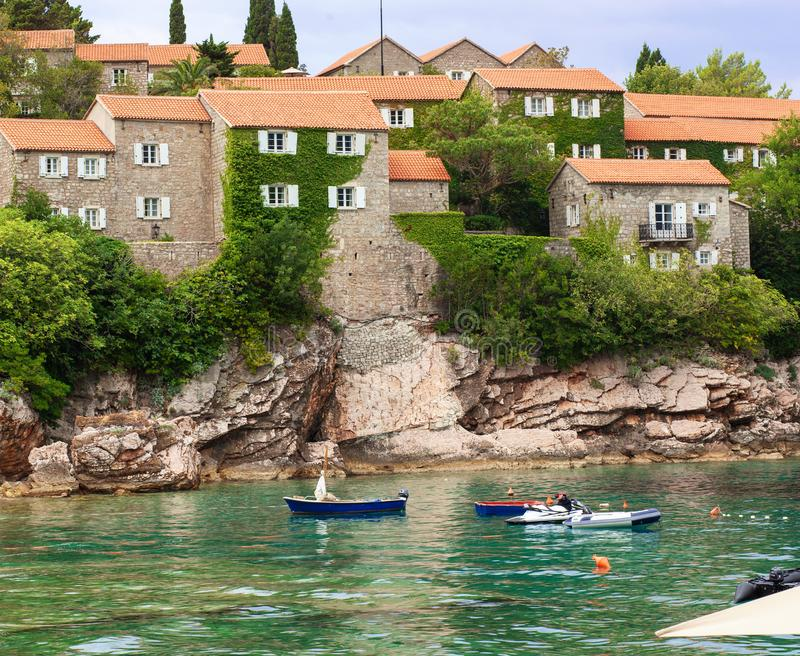 Sveti Stefan island in Budva, Medieval castle, Montenegro. Adriatic sea with boats stock photos
