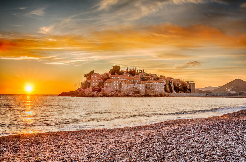 Sveti Stefan Island in Budva, Montenegro. With a beautiful sunset in HDR royalty free stock images