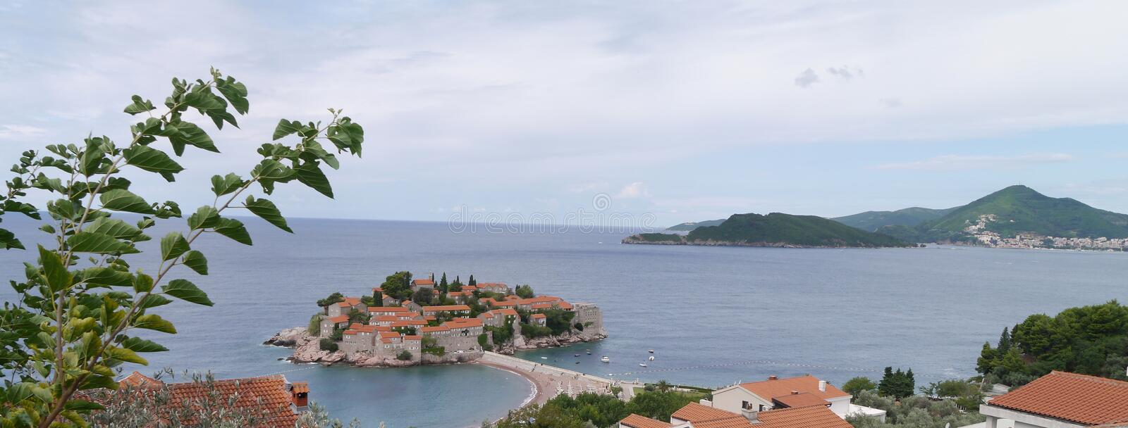 Sveti Stefan Island, Montenegro. Beach and resort.The luxe 1- and 2-bedroom suites and cottages in stone buildings have stylish, contemporary decor, along with royalty free stock photos