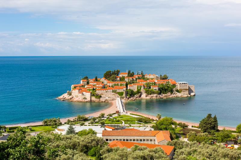 Sveti Stefan Island in Montenegro, owned by the Amman Hotel, in the blue sea stock images