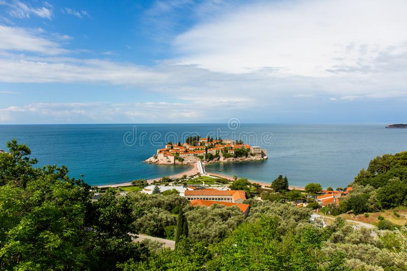 Sveti Stefan Island in Montenegro, owned by the Amman Hotel, in the blue sea. Sveti Stefan Island in Montenegro, owned by the Amman Hotel, is a charming island royalty free stock image