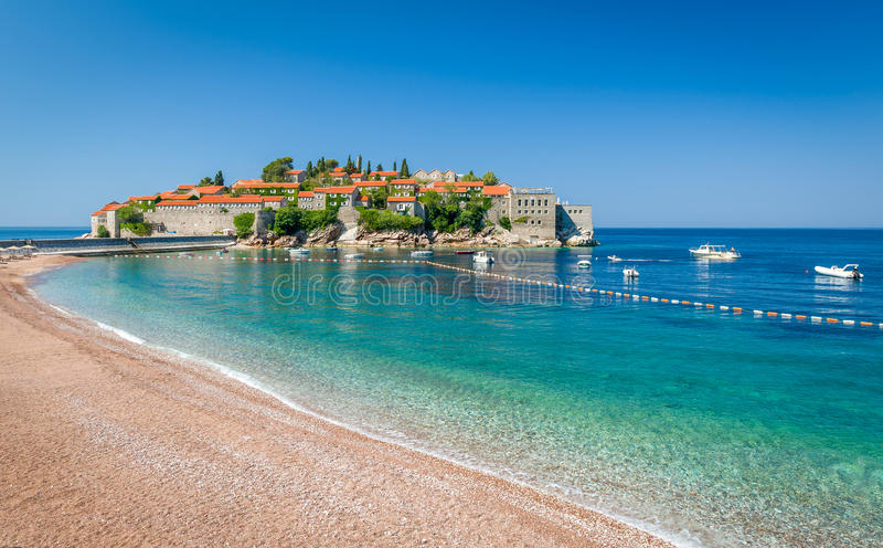 Sveti Stefan island and paradise beach in Montenegro. Sveti Stefan historical town island and paradise sand beach. Budva, Montenegro stock image