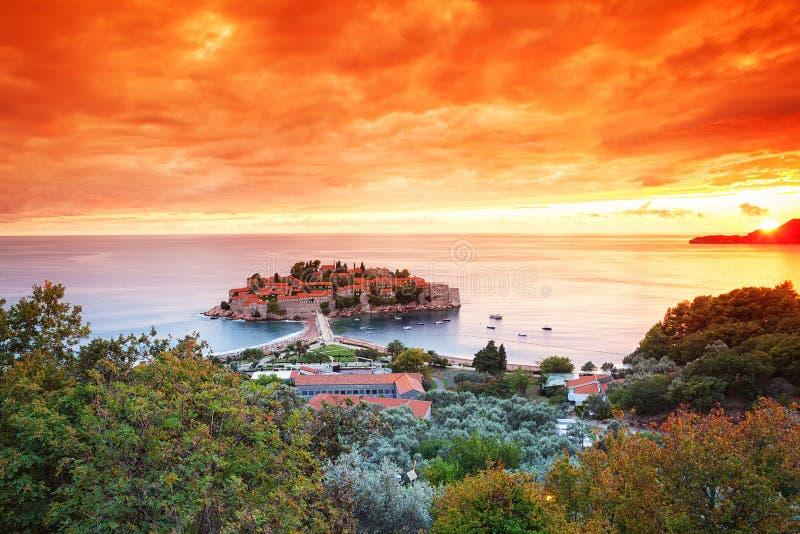 Sveti Stefan, Montenegro. Balkans, Adriatic sea, Europe. View of beauty sunset over Sveti Stefan, small islet and resort in Montenegro. Balkans, Adriatic sea royalty free stock photography
