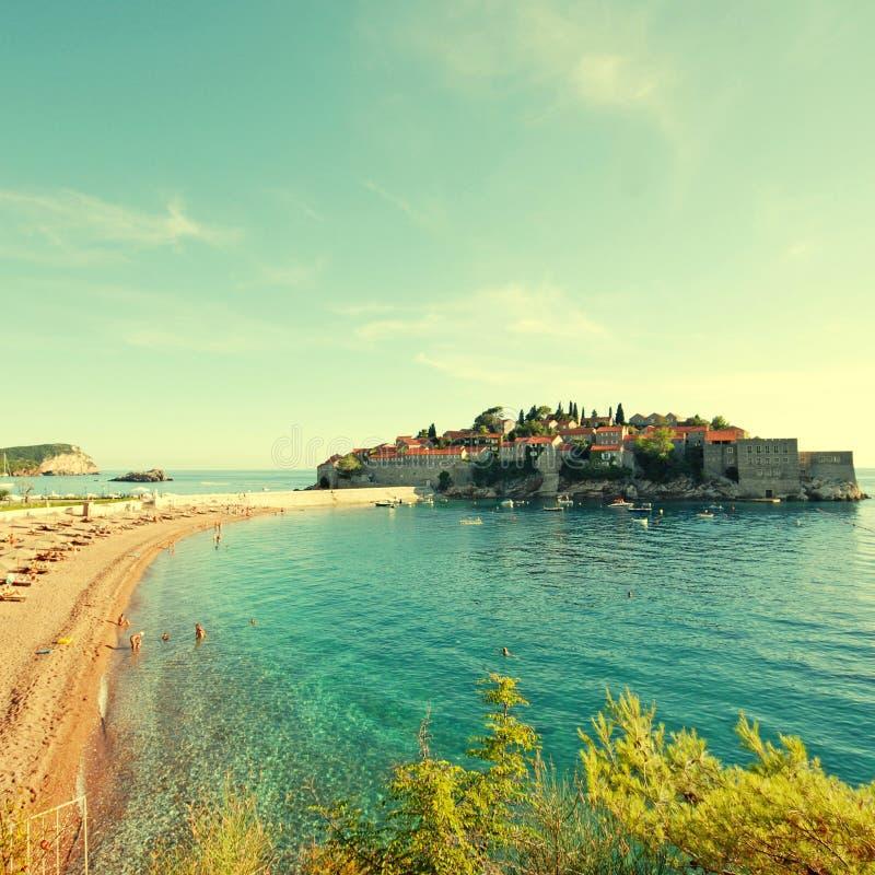 Sveti Stefan, Montenegro. Famous island-hotel Sveti Stefan, Montenegro in afternoon sunlight, square toned image, instagram effect stock photo