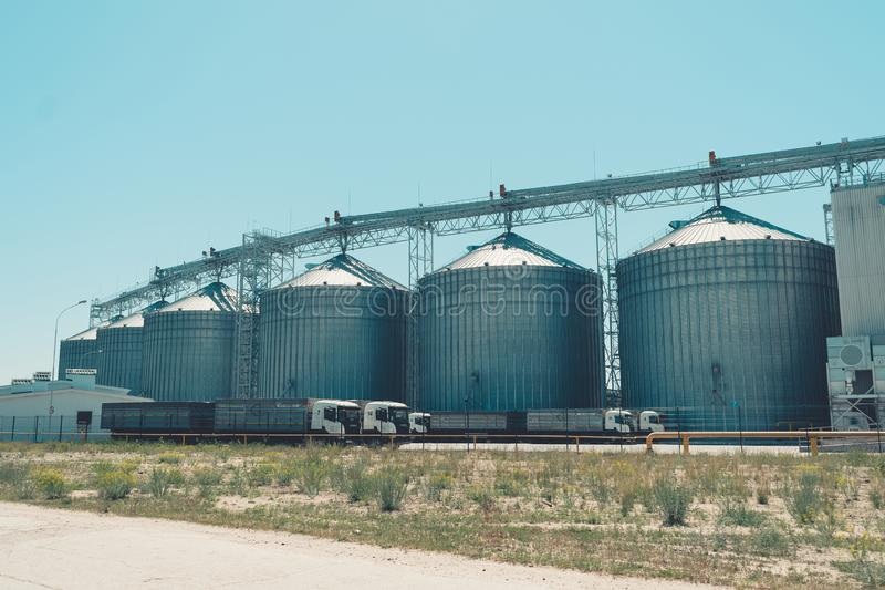 Svetlovodsk, Ukraine  – 27 May, 2018: Modern Agricultural Silos against blue sky. Storage and drying of grains, wheat, corn, soy stock image
