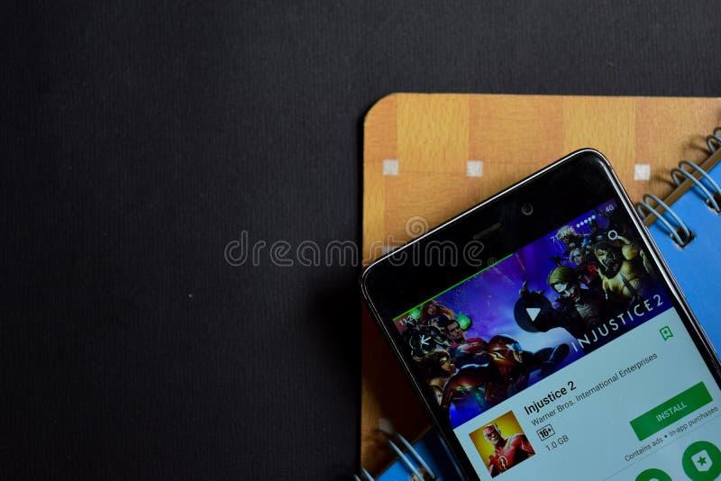 Sviluppatore app di ingiustizia 2 sullo schermo di Smartphone fotografia stock libera da diritti