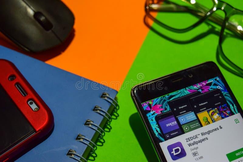 Sviluppatore app di suonerie & della carta da parati di ZEDGE sullo schermo di Smartphone fotografia stock