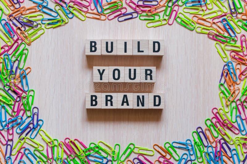 Sviluppi il vostro concetto di parole di marca fotografia stock