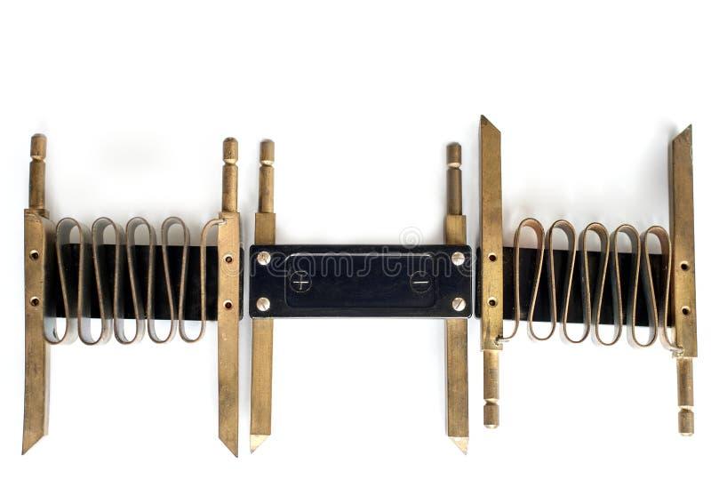Sviluppi a spirale per il voltometro su uno strato bianco fotografia stock