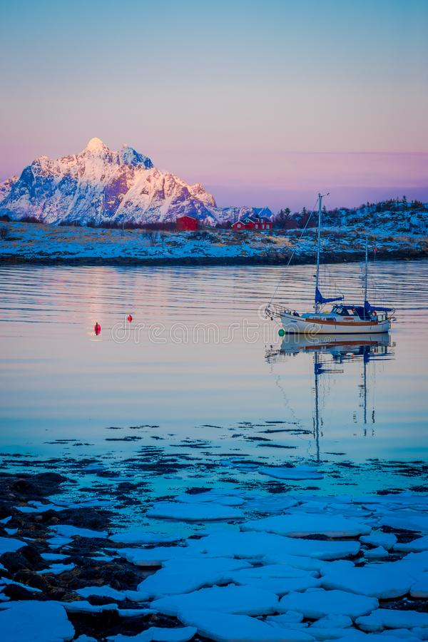 SVOLVAER, LOFOTEN ISLANDS, NORWAY - APRIL 10, 2018: Outdoor view of pieces of ice on the beach with a partial frozen stock images