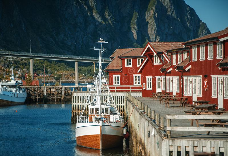 Svolvaer, Lofoten norway, boat in port, mountains and traditional red rorbu fishing houses, beautiful cityscape stock photo