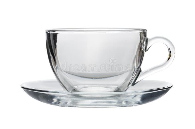 Svuoti il tazza da the trasparente con il piattino isolato su bianco immagini stock libere da diritti
