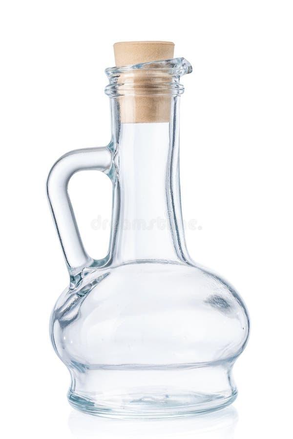 Svuoti la piccola bottiglia per olio d'oliva con il tappo del sughero isolato su w fotografie stock