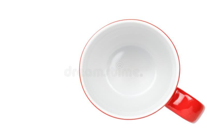 Svuoti la tazza di caff? rossa isolata su fondo bianco Con il percorso di ritaglio immagini stock