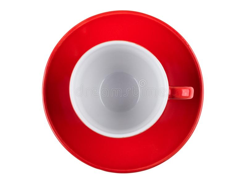 Svuoti la tazza ed il piattino di caffè rossa isolati su fondo bianco fotografia stock libera da diritti